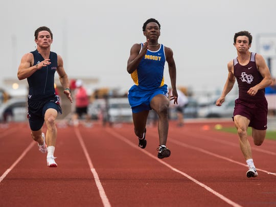 Moody's Brailon Sanders wins the 100-meter dash in the District 30-5A track meet at Ray Akins Wildcat Stadium in Portland on Thursday, April 5, 2018.