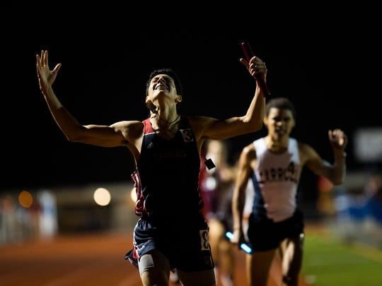 Veterans Memorial's Alfredo Martinez crosses the finish line to win the boys 1,600-meter relay on Thursday at the District 30-5A meet in Portland. The Eagles won the boys championship.