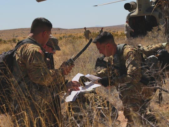 Pilots and flight crews from the 2-501st sharpen their survival and evasion skills during a field training exercise.
