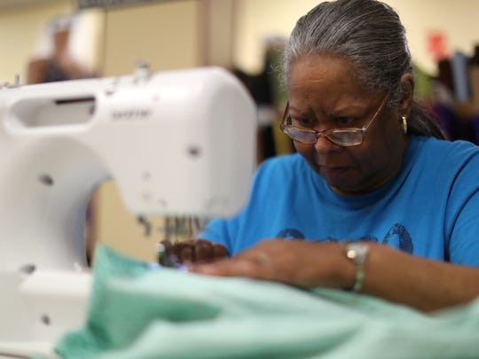 Student Beverly Roberts works on creating a skirt at