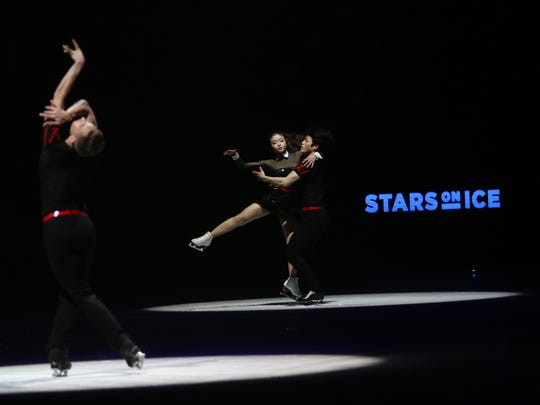 Olympian Adam Rippon, left, and Maia and Alex Shibutani perform during the first night of the Stars on Ice tour at Germain Arena on Friday, April 6, 2018.