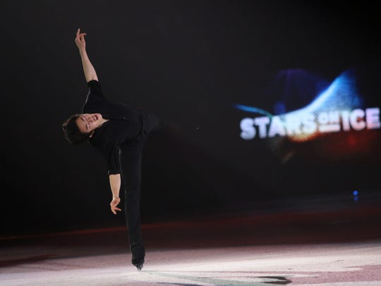 Olympic star Nathan Chen performs during the first
