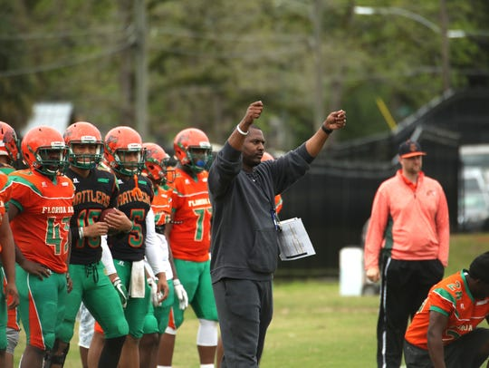 FAMU coach Willie Simmons signals in an offensive play