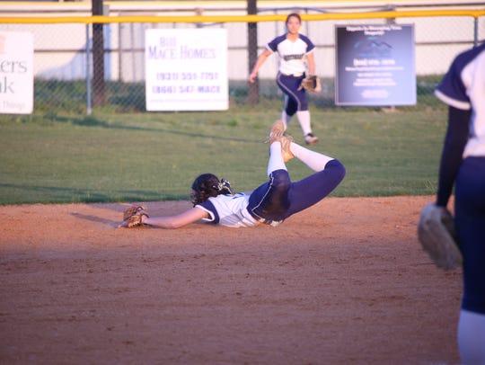 Northeast shortstop Lauren Veltri stretches to snag