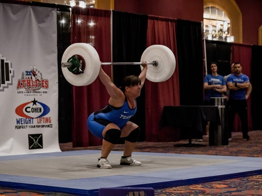 Estero's Janine Giovinazzi completes a snatch lift during the USA Masters Weightlifting National Championship in Buffalo, New York.