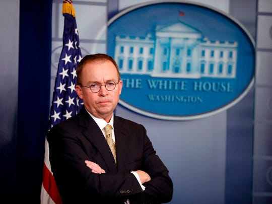 Director of the Office of Management and Budget Mick Mulvaney stands during a press briefing at the White House in Washington. Mulvaney, appointed acting director of the Consumer Financial Protection Bureau in November, promised to shrink the bureau's mandate and take a much softer approach to enforcement, and records reviewed by The Associated Press indicate he has kept his word.