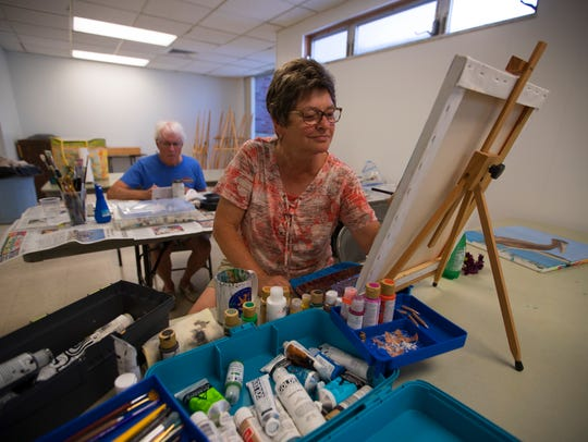 Cape Coral resident Dyann Miller, paints in acrylic