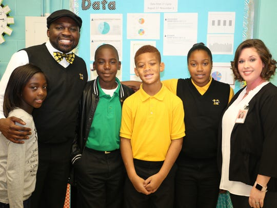 Marvin Rainey with students. The Midway principal was selected as the newest fellow of the Leverage Leadership Institute.