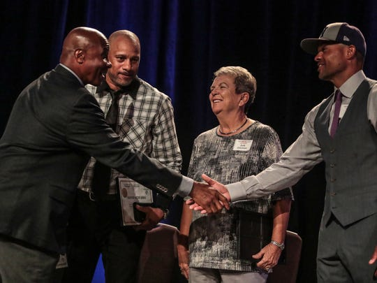 Lynn Swann, retired NFL player and broadcaster, greets retired NBA player Pooh Richardson, former Cal State Fullerton head softball coach Judi Garman, and former MLB player Coco Crisp on stage during the Boys and Girls Club of Coachella Valley's Sports Hero Luncheon on Wednesday, April 11, 2018 in Indian Wells.
