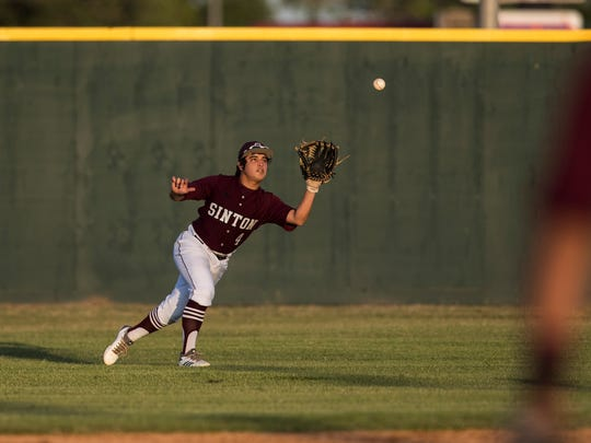 Sinton's  Alec Cancino catches a ball  during their