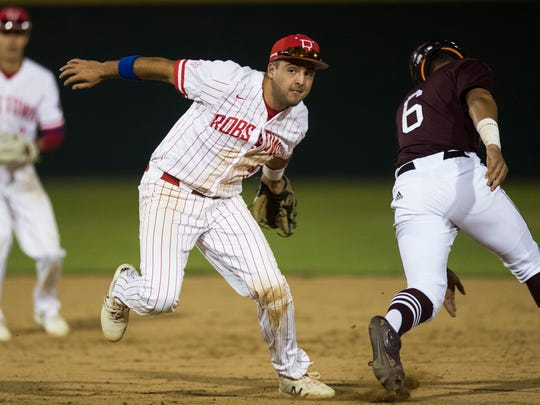 Robstown's Austin Kwiatkowski tags Sinton's Christian  Bess during their game Tuesday, April 10, 2018 at Steve Castro Field in Robstown.