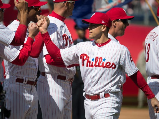 Phillies' Scott Kingery enters the field during player introductions at the Phillies home opener at Citizens Bank Park.
