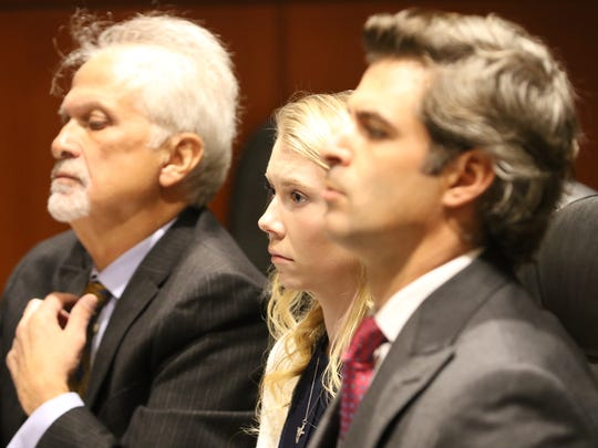 Skylar Richardson with attorneys Charlie H. Rittgers (left) and Charlie M. Rittgers (right) during pretrial hearing.