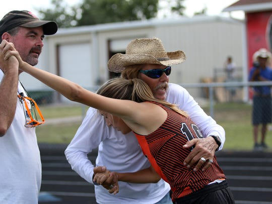 Athletes compete in the Class 2A District 12 meet at