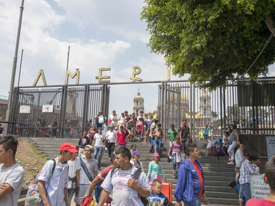 Migrants from Central America leave Basilica of Our