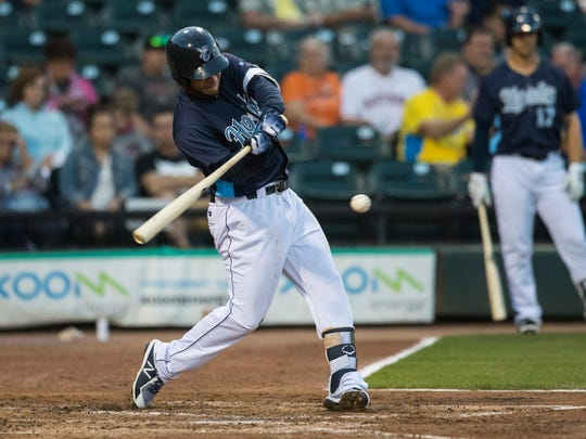 Hook's Randy Cesar hits the ball during their season opener against Northwest Arkansas Naturals on Thursday, April 12, 2018 at Whataburger field.