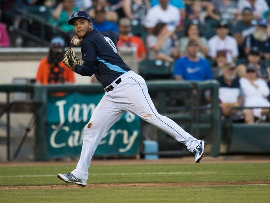 Hook's Randy Cesar attempts to throw out a runner during their season opener against Northwest Arkansas Naturals on Thursday, April 12, 2018 at Whataburger field.
