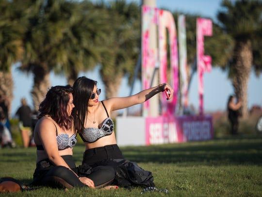 Two girls pose for a selfie at Fiesta de la Flor on
