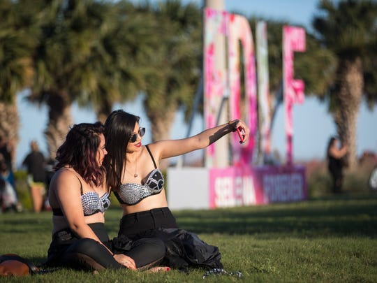 Two girls pose for a selfie at Fiesta de la Flor on Saturday, April 14, 2018 at the American Bank Center.
