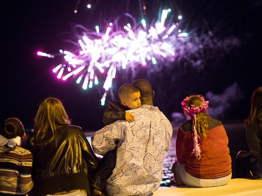 People watch fireworks at Fiesta de la Flor on Saturday, April 14, 2018 at the American Bank Center.