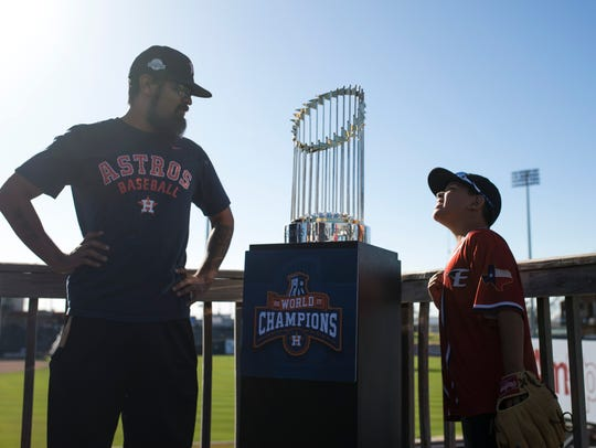 Rico Cano (left) and his son Uriyah Cano, 8, admire