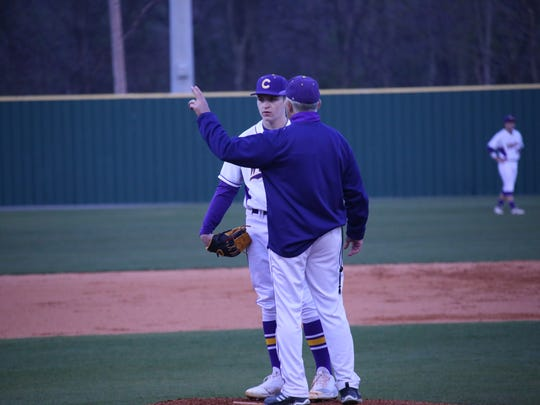 Clarksville High head coach Brian Hetland offers pitching