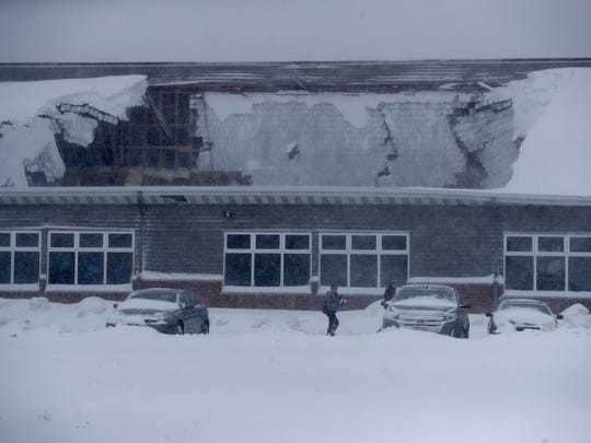 Heavy snow caused a partial collapse of the roof Sunday morning at the Econo Lodge hotel in in Ashwaubenon.