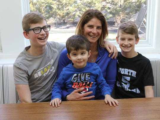 Champ with her sons, from left, Harrison, Bode and