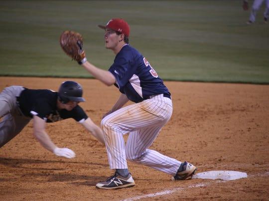 Creek Wood's first baseman Sam Batey waits for the
