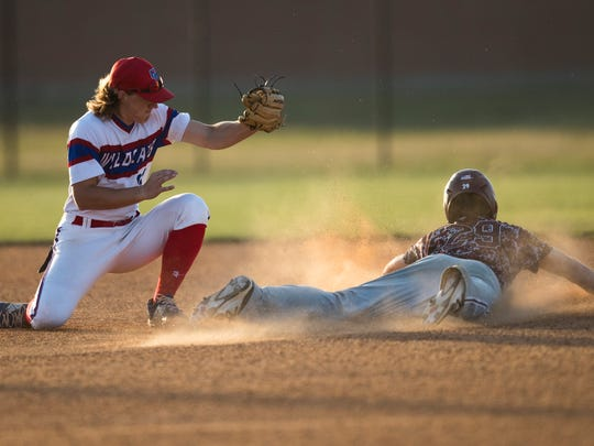 Calallen's Colton Duff steals second base against Gregory-Portland's Ryan Stark tries to tag on Tuesday, April 17, 2018 at Gregory-Portland.