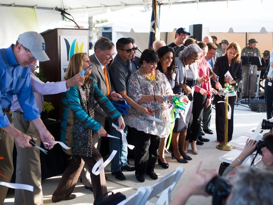 Corpus Christi officials cut a ribbon during a ceremony