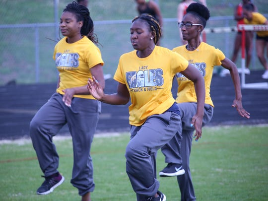 Northeast's Calandra Henry (center) warms up with teammates