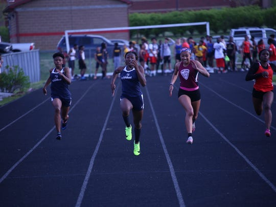 Northeast's Calandra Henry (center) outpaces her competition