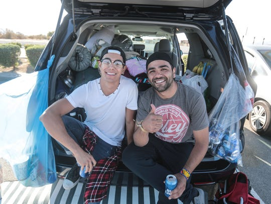Coachella Music Festival campers hang out at the Walmart parking lot in Indio on Thursday, April 19, 2018. High winds delayed campers from entering the festival grounds.