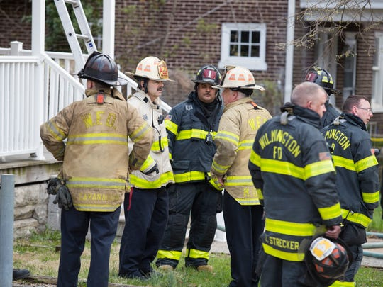 Wilmington firefighters work the scene of a house fire