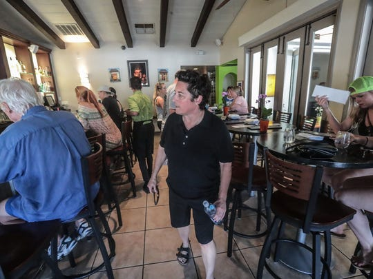 Sunny Cycle owners Shannon Miller makes sure her tour group are comfortable at the Watercress restaurant in Palm Springs on Thursday, April 12, 2018. Former Minnesota State University coaches, Shannon Miller and Jennifer Banford, opened the cycle party tour business soon after they were let go from their university coaching jobs for which they filed sexual discrimination and pay inequity lawsuits against the University.