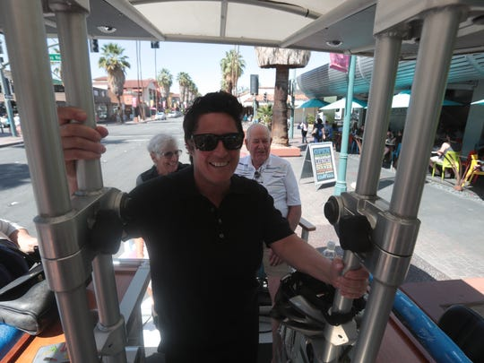 Shannon Miller gives the Sunny Cycle tour in the back mobile-bar-party-cycle on Thursday, April 12, 2018 in Palm Springs.