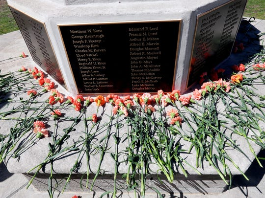 Ninety-six carnations were placed at the base of the flagpole outside Bronxville High School in Bronxville, N.Y. on April 20, 2018, in honor of the those killed by gun violence every day. About 80 students staged a walkout and a rally to protest gun violence and to commemorate the 19th anniversary of the shootings at Columbine High School. The students marched through downtown Bronxville to nearby Christ Church where they held a rally.