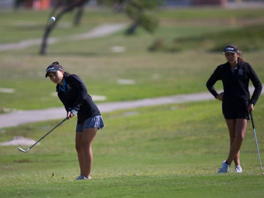 Flour Bluff's Kaylie Chapa (left) and Katie Habib practice for the regional tournament on Thursday, April 19, 2018 at Gulf Winds golf course.