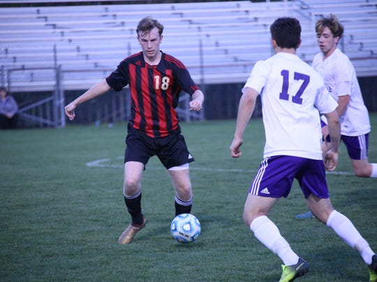 Rossview's Blake Campbell (18) and Clarksville High's