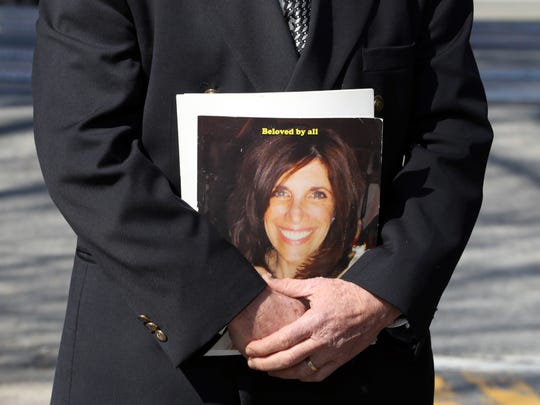 Alan Brody holds a photo of his wife Ellen as he, State