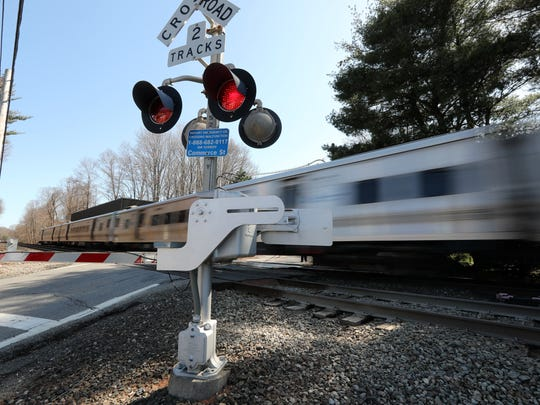 A Metro-North train passes at the site of the fatal 2015 Metro-North crash in Valhalla on April 20, 2018. Alan Brody, state Sen. David Carlucci, and Assemblyman Tom Abinanti spoke at the site calling on the Department of Transportation to finish its study of railroad crossings and act to make the crossings safer. Brody's wife Ellen was driving the vehicle that was struck by the Metro-North train in the crash that killed her and five others.