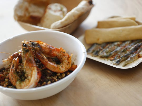 Boquerones (right), bufala ricotta (back) and the Ramon Navarro bowl with shrimp at Pa'La in Phoenix.