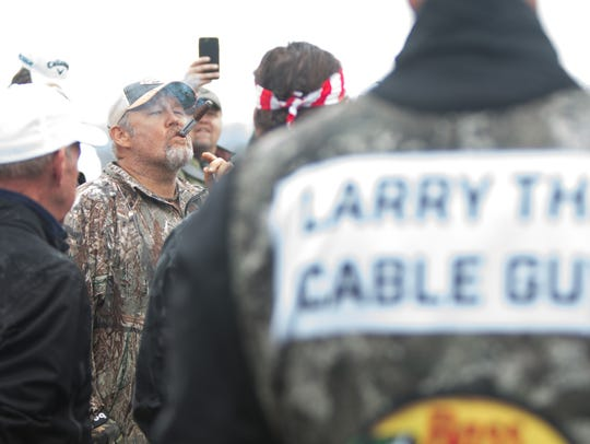 Larry the Cable Guy puffs on his cigar before starting