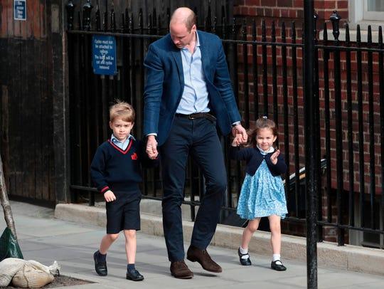 Princess Charlotte of Cambridge waves at the media