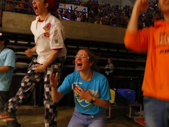 Annabelle Wojahn cheers as Wave's alliance wins a tough final match.