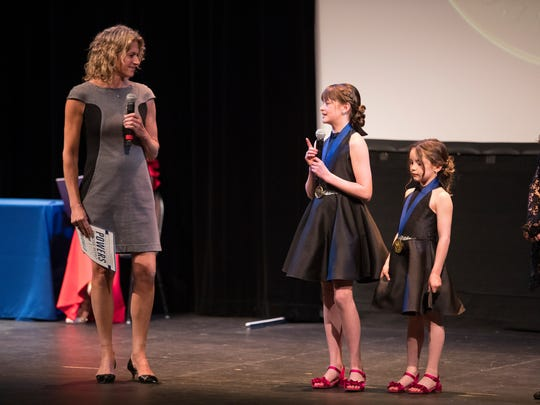 CEO of the Jefferson Awards Foundation Hillary Schafer speaks to LEAD360 winner Reagan and Payton Garnsey during the Jefferson Awards Foundation Delaware Salute to Service Monday night at the Baby Grand.