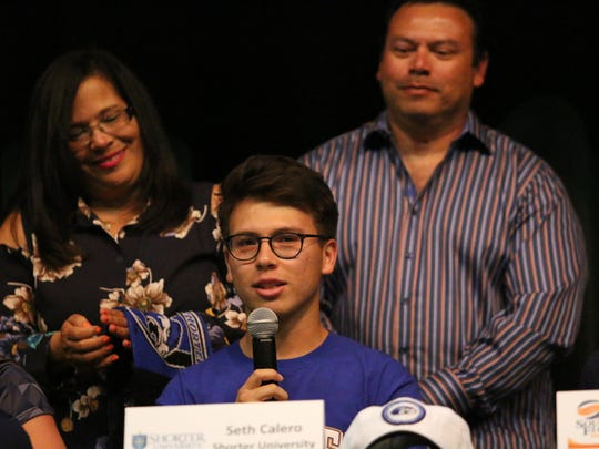 Seth Calero speaks to the crowd after signing his letter of intent to play soccer at Shorter University during Palmetto Ridge High School's signing ceremony on Tuesday, April 24, 2018.