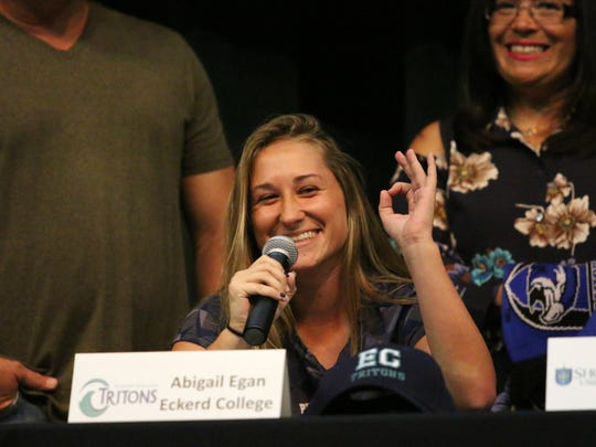Abby Egan thanks her friends of family after signing her letter of intent to play soccer at Eckerd during Palmetto Ridge High School's signing ceremony on Tuesday, April 24, 2018.