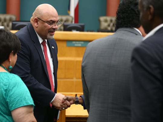Everett Roy shakes people's hands after being appointed to the District 1 seat of the Corpus Christi city council on Tuesday, April 24, 2018 at city hall.